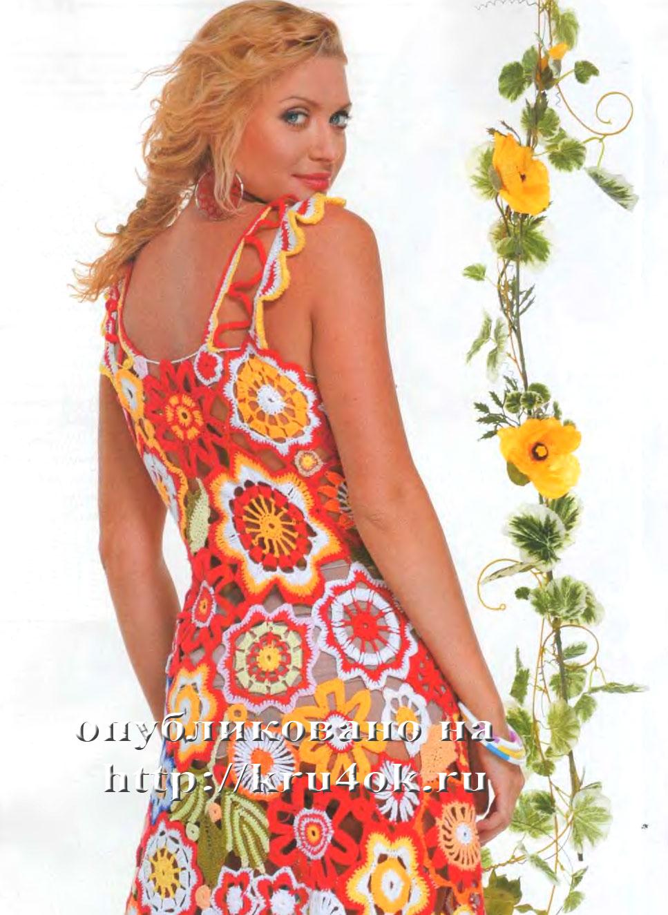 Мария Сергеевна.  Яркий сарафан, связанный крючком.  Соцветие фантазийных цветов, яркие сочные краски...