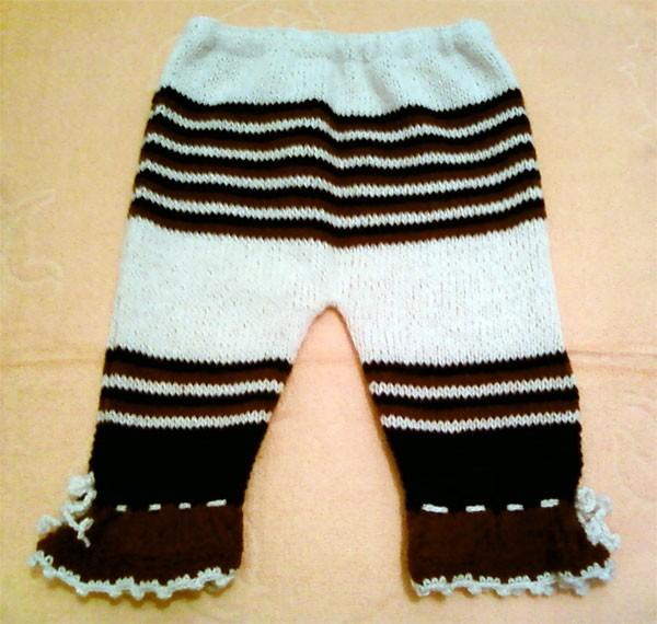 Ольга прислала новые работы: летние панамки и штанишки.  Штанишки связаны спицами, а панамки - крючком.