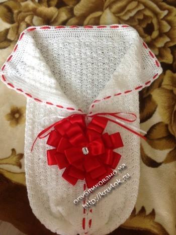 фото вязаного конверта для малыша