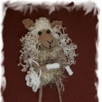 Вязаная игрушка овечка — работа Елены