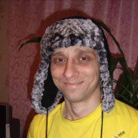 Мужская шапка крючком — работа Меньшиковой Анны